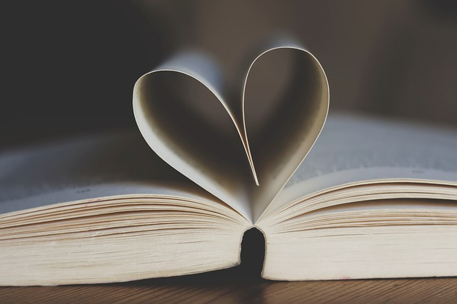 book with some pages folded into a heart